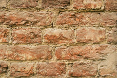 Background of old vintage brick wall. Fragment Stock Photo