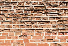 Background of old vintage crumbling brick wall on sunny day Royalty Free Stock Photo