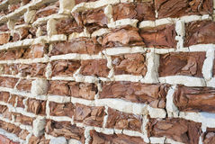 Background of old vintage crumbling brick wall Stock Photos