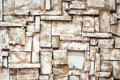 Background of old vintage dirty brick wall with peeling plaster Royalty Free Stock Photography
