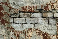 Background of old vintage dirty brick wall with peeling plaster stock photos