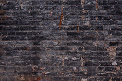 Background of old vintage dirty brick wall with peeling plaster, texture Stock Images