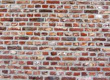 Background of old vintage dirty brick wall with peeling plaster, texture. Royalty Free Stock Photos
