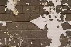 Background of old vintage dirty brick wall with peeling plaster, texture.Brick white, brown. Peeled paint on a brick wall royalty free stock images
