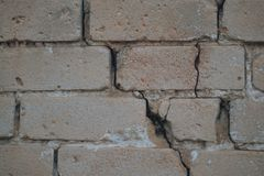 Background of old vintage dirty brick wall with peeling plaster, texture royalty free stock photo
