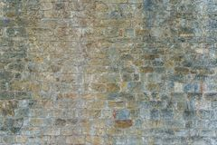 Background of old vintage stone wall. Background or texture of old vintage stone wall Royalty Free Stock Photos
