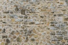 Background of old vintage stone wall. Background or texture of old vintage stone wall Stock Photos