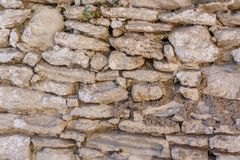 Background of old vintage stone wall. Background or texture of old vintage stone wall Stock Image