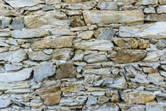 Background of old vintage stone wall. Background or texture of old vintage stone wall Stock Photo