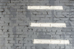 Background of old vintage white brick wall texture with white lines of light Royalty Free Stock Images
