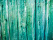 Background old vintage wooden wall board. Background vintage old vintage green wooden fence Stock Photo