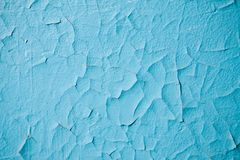 Background wall with blue cracked plaster royalty free stock images