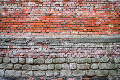 Background old wall bricks and stones. Background of an old wall of different bricks and stones. vintage grunge texture Royalty Free Stock Photo