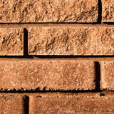 The background of the old wall of the porous brick Stock Images