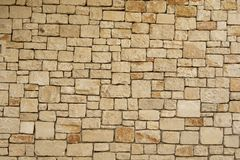 Background of old wall texture, traditional Mallorcan ashlars. Traditional Mallorcan ashlars. Walls of the village of Santanyi Stock Photos