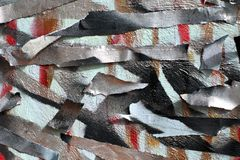 Background of old wall with unpainted colored lines. Stencil with masking tape. Red black and blue layers stock image