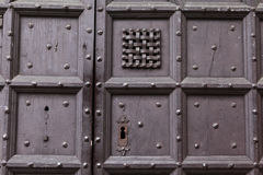 Background: old wooden door. Style Medieval Europe & x28;France& x29;. Royalty Free Stock Images