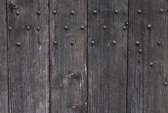 Background: old wooden door. Style Medieval Europe & x28;France& x29;. Stock Photo