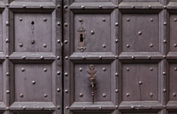 Background: old wooden door. Style Medieval Europe & x28;France& x29;. Royalty Free Stock Photography