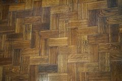 Background of old wooden herringbone parquet flooring composed of boards. Background of old wooden herringbone parquet flooring composed of boards of a Royalty Free Stock Images