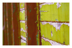 Background old wooden rustic, green door detail with peeling of. Background, old wooden rustic, green door detail with peeling off paint, metal lath and bots Royalty Free Stock Image