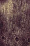 Background of old worn darkened from time to time, brown wooden plank.  stock images