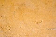 Background of old yellow grunge wall Stock Image