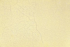 Background of old yellow painted wall. Detail of a damaged wall and abandoned Royalty Free Stock Photography