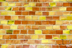 Background of old yellow. red and brown vintage brick wall.  stock photo