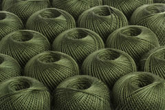 Background olive yarn. Texture of colored yarn skeins stock images