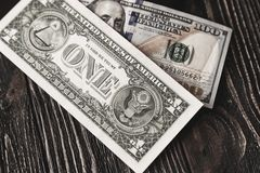 Background of one hundred and one dollar bills on dark wooden background Royalty Free Stock Photo