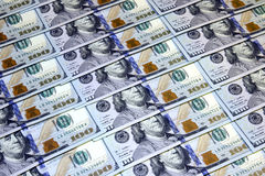 Background of one hundred dollars banknotes. The background of hundred dollar bills of the new sample Royalty Free Stock Photo