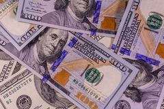 Background of one hundred dollars bills. Heap of the one hundred dollars bills for background Stock Photo