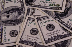 Background of one hundred dollars bills. Heap of the one hundred dollars bills for background Royalty Free Stock Photography