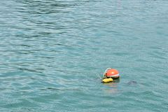 Background of an orange ball buoy floating in the sea. Royalty Free Stock Photography