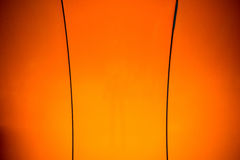 Background in orange with black stripes curve Stock Photos