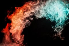 A background of orange, green and red wavy smoke of mystical app. Earance on a white ground. Bright abstract pattern of steam from vape stock image