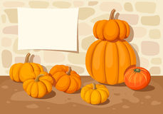 Background with orange pumpkins and a stone wall. Vector illustration. Vector background with orange pumpkins, a stone wall and a blank placard Stock Image