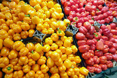 Background of orange and red bell peppers Stock Photos