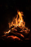 Background of orange and red sparks from a campfire at night Stock Image