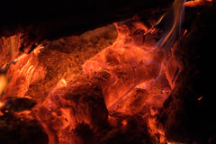 Background of orange and red sparks from a campfire at night Royalty Free Stock Images