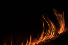 Background of orange and red sparks from a campfire at night Stock Photos