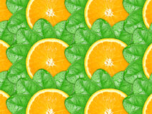 Background of orange slices and green leaf Stock Photo