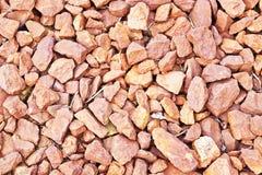 Background of orange stones Royalty Free Stock Photos