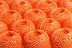 Background orange yarn. Texture of colored yarn skeins royalty free stock image