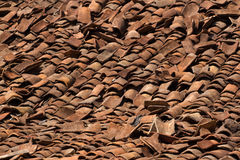 Background ornament terracotta red ancient tiles. Destructed riuined roof, India, Karnataka Stock Image