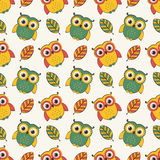 Background with owls and leaves. Vector seamless pattern. Stock Photos