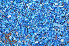 Background of painted wood chips. Background of painted blue wood chips on the soil in the garden Royalty Free Stock Image