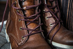 Background of pair or couple Close up view of brown leather man or woman new dry clean shoes, showing laces in detail. Royalty Free Stock Images