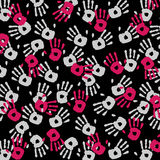 Background of palms. Prints in gray and pink hands on a black background Vector Illustration